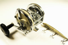 Antique Ocean Fishing Reel and Lure Stock Photography