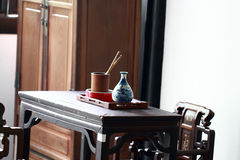 Antique office furniture,Ancient desks. Wooden antique office furniture with Asian Chinese traditional design and pattern in workplace. Office mahogany wood desk royalty free stock photography