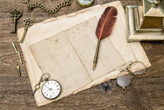 Antique office supplies and accessories, used paper, feather pen Stock Images