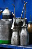 Antique oil cans. In a workshop Stock Photo
