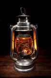 Antique Oil Lamp. Lighting up the Darkness Stock Images