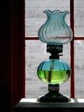 Antique Oil Lamp. In western pioneer log cabin Stock Photos