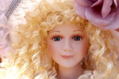 Antique old blond porcelain doll face protrait Stock Photos
