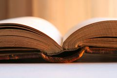 Antique old book glowing in sunlight royalty free stock photo