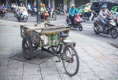 Antique old cargo bicycles, cargo tricycles. Stock Photos