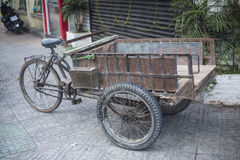 Antique old cargo bicycles, cargo tricycles. Stock Image