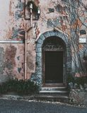 Antique old door with arch on top royalty free stock images