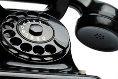 Antique, old retro. An old, old landline telephone. Phone on a white background Stock Photos