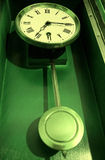 Antique old retro pendulum clock Royalty Free Stock Image