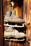 Antique old style retro object assemblage on a wooden wall, rustic stile. Old skates. Stock Photos