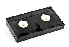 An antique old video cassette tape. On an isolated white background stock image