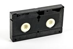 An antique old video cassette tape. On an isolated white background stock photography