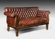 Antique old vintage brown leather studded cushioned couch sofa Royalty Free Stock Images