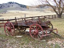 ANTIQUE OLD WAGON - COVERED WAGON IN THE MOUNTAINS Royalty Free Stock Photo