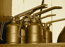 Antique Oli Cans On Shelf In Sepia Tone Royalty Free Stock Photo