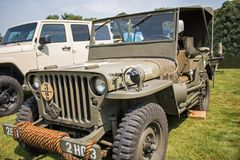 Antique Olive Drab Military Jeep. United States Military World War II era antique olive drab green Jeep from 1940`s stock photography