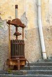 Antique olive press. Stock Photos