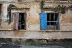 Antique wooden windows on grunge wall Stock Photography