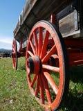 Orange wagon wheel. Antique Orange wooden wagon wheel royalty free stock photography