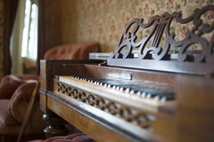 Antique Organ/Piano in Old Fashioned Parlor royalty free stock images