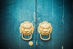 Antique oriental door knocker. Closeup of the antique oriental door knocker royalty free stock image