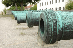 Antique ornamented cannon barrels Royalty Free Stock Images