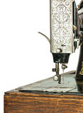 Antique ornate sewing machine. Closeup of a beautiful antique sewing machine threaded and ready for use Stock Images