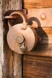 Antique padlock. Old and antique locked padlock on wooden door representing concept of security Royalty Free Stock Photography