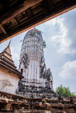Antique pagoda and ruined sanctuary in Wat Putthaisawan Stock Photo