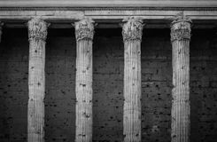Temple Of Hadrian Rome. Antique stone columns of Hadrian Temple in Rome, Italy, black and white architecture photography Stock Photo