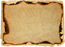 Antique paper with burned edges. Image of the old crumpled paper with burned edges. Add any your text anywhere royalty free stock photography