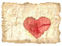 Antique paper and heart. Old and yellow sheet of paper with red heart Royalty Free Stock Photo