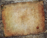 Antique paper scroll on the  wall Royalty Free Stock Photos