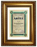 Antique paper share certificate. Of the german steel company in wooden frame Royalty Free Stock Image