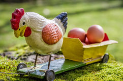 Antique papier mâché rooster on a cart Stock Image