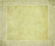 Antique parchment with embossed frame. Textured background Royalty Free Stock Photos