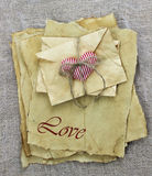 Antique parchment paper love letters and envelopes with red heart Royalty Free Stock Photography