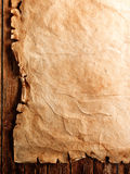 Antique Parchment on Wood Stock Images