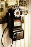Antique Payphone. This image of an antique Payphone is tinted slightly to create an old rustic look. Film noise effect is intentionally added into the picture Royalty Free Stock Photography