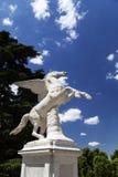 Antique Pegasus sculpture in Boboli Gardens  in Florence, Italy. Antique Pegasus sculpture on a backkground on blue sky in Boboli Gardens  in Florence, Italy Royalty Free Stock Photos