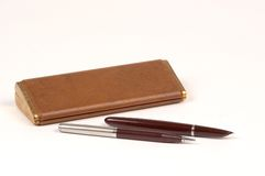 Antique pen and pencil set. Antique fountain pen and mechanical pencil set fromthe 1950's Royalty Free Stock Photography