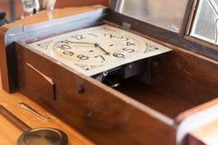 Antique pendulum clock restoration. A broken pendulum clock on a wood table Stock Photo