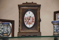 Antique pendulum wall clock Royalty Free Stock Images