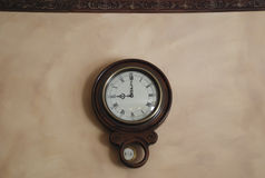 Antique pendulum wall clock Royalty Free Stock Photos