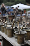 Antique pestle mill. Antique bronze mortar and pestle on a table Stock Photos