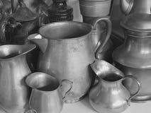 Jars and bottles. Antique pewter jars Stock Image