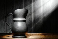 Antique Pewter Pitcher on Old Historic Wood Shelf royalty free stock images