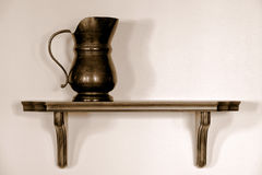 Antique Pewter Pitcher on Old Wood Shelf Royalty Free Stock Photos