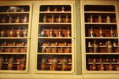 Antique pharmacy antidotes on a shelf. stock image