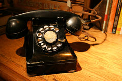 Antique Phone. Antique Black Phone on a Desk. Aurora Mills Architectural Salvage Stock Image